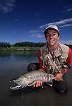 Phillip Mc Knight with a chum salmon in Alaska