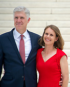Associate Justice of the Supreme Court of the United States Neil M. Gorsuch, left, and his wife, Marie Louise, right, pose for photos on the front steps of the US Supreme Court Building after the investiture ceremony for Justice Gorsuch in Washington, DC on Thursday, June 15, 2017. <br /> Credit: Ron Sachs / CNP