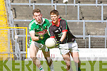 Paul Carroll Milltown/Castlemaine and Conor Keane legion in action during their Club Championship semi final on Sunday