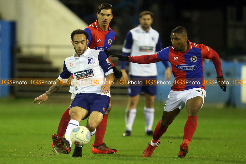 Byron Harrison of Barrow and Andre Boucaud of Dagenham during Barrow vs Dagenham & Redbridge, Vanarama National League Football at the Furness Building Society Stadium on 9th December 2017