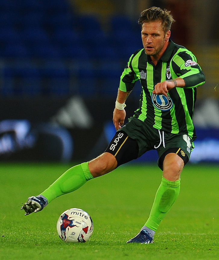 AFC Wimbledon's Dannie Bulman in action during todays match  <br /> <br /> Photographer Craig Thomas/CameraSport<br /> <br /> Football - Capital One Cup First Round - Cardiff City v AFC Wimbledon - Tuesday 11th August 2015 - Cardiff City Stadium - Cardiff <br /> &copy; CameraSport - 43 Linden Ave. Countesthorpe. Leicester. England. LE8 5PG - Tel: +44 (0) 116 277 4147 - admin@camerasport.com - www.camerasport.com