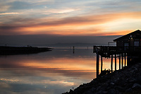Smoke from wildfires in southern California has traveled the 300 miles up the coast to the San Francisco Bay area.  Sunset at the San Leandro Marina.