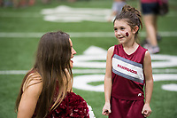 NWA Democrat-Gazette/J.T. WAMPLER Havyn Hale ((CQ)), 7, of Greenland visits with Razorback pom-pom squad member Lauren Bouvier Saturday August 12, 2017 during the RazorbacksÕ annual Fan Day at the University of Arkansas. Football players and coaches were available for autographs with the soccer and volleyball teams.