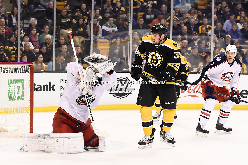 Monday, February 22, 2016: Columbus Blue Jackets goalie Joonas Korpisalo (70) makes a glove save in front of Boston Bruins left wing Matt Beleskey (39) during the National Hockey League game between the Columbus Blue Jackets and the Boston Bruins, held at TD Garden, in Boston, Massachusetts. The Blue Jackets defeat the Bruins 6-4. Eric Canha/CSM<br /> <br /> *** Headline correction *** This corrects an earlier version that headlined the game as Blues vs Bruins FEB 22.