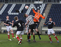 Graham Bowman punches clear under pressure from Jason Naismith at the Falkirk v St Mirren  Scottish Football Association Youth Cup 4th Round match played at the Falkirk Stadium, Falkirk on 16.12.12.