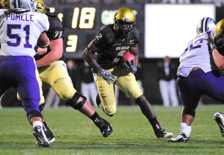 18 October 08: Colorado running back Darrell Scott looks for a hole as he rushes against Kansas State. The Colorado Buffaloes defeated the Kansas State Wildcats 14-13 at Folsom Field in Boulder, Colorado.