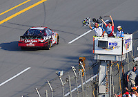 Apr 26, 2008; Talladega, AL, USA; NASCAR Nationwide Series driver Tony Stewart (20)takes the checkered flag to win the Aarons 312 at the Talladega Superspeedway. Mandatory Credit: Mark J. Rebilas-
