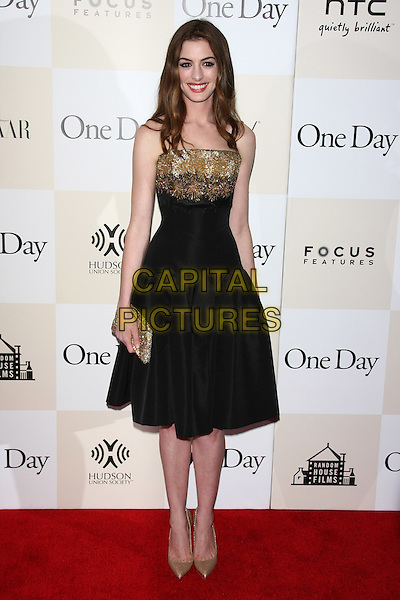"Anne Hathaway .The New York Premiere of ""One Day"" held at AMC Loews Lincoln Square Cinemas, New York, NY, USA..August 8th, 2011.full length black dress gold strapless beads beaded shoes clutch bag.CAP/LNC/TOM.©LNC/Capital Pictures."