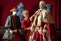 BNPS.co.uk (01202 558833)<br /> Pic: PhilYeomans/BNPS<br /> <br /> Denise with John Sackville, 3rd Duke of Dorset and his Chinese page Huang ya Dong. The 3rd Duke was a leading cricketer in the earliest days of the sport.<br /> <br /> Wasted Paper...This might be the only chance history fans get to see the incredible paper creations that tell the story of one of Britain's most historic homes, as the National Trust becomes the latest victim of coronavirus.<br /> <br /> 'Fashioned from Paper' had only just opened at Knole House near Sevenoaks before the National Trust annouced the closure of the historic Kent property from today.<br /> <br /> Now Artist Denise Watson's intricate creations may never be seen as know one knows when the historic home will reopen.<br /> <br /> Denise had taken inspiration from the valuable collection of portrait paintings bought up by the aristocratic Sackville-West family over the stately homes 600 year history.<br /> <br /> The enormous building, one of the largest houses in Britain, was once owned by Archbishop Thomas Cranmer before Henry VIII th covetous gaze forced him to hand it over to the acquisitive monarch in the mid 16th century.<br /> <br /> Elizabeth I later gifted Knole to Thomas Sackville, 1st Earl of Dorset, and the Sackville-West's still inhabit part of the property to this day.