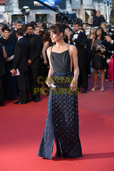 Milla Jovovich.'Cleopatra' premiere at the 66th  Cannes Film Festival, France..21st May 2013.full length blue black dress skirt top sleeveless beads beaded embellished jewel encrusted clutch bag silver profile .CAP/PL.©Phil Loftus/Capital Pictures.