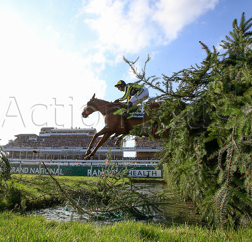 14h April 2018, Aintree Racecourse, Liverpool, England; The 2018 Grand National horse racing festival sponsored by Randox Health, day 3;  David Bass leads The Last Samurai over the water jump