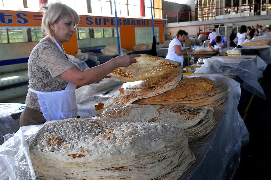 "Women cooking traditional armenian bread ""Yavash"""