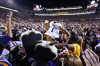 The LSU mascot 'Mike the Tiger' is hoisted by fans after they defeated Mississippi in their NCAA college football game in Baton Rouge, La., Saturday, Oct. 25, 2014. LSU won 10-7.