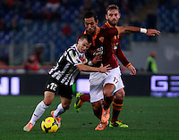 Calcio, quarti di finale di Coppa Italia: Roma vs Juventus. Roma, stadio Olimpico, 21 gennaio 2014.<br /> Juventus forward Sebastian Giovinco, left, and AS Roma defender Mehdi Benatia, of Morocco, fight for the ball as AS Roma midfielder Daniele De Rossi, right, looks on, during the Italian Cup round of eight final football match between AS Roma and Juventus, at Rome's Olympic stadium, 21 January 2014.<br /> UPDATE IMAGES PRESS/Isabella Bonotto