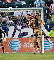 Chivas USA defender Michael Umana (4) goes up high against Philadelphia Union forward Sebastien Le Toux (9) during the first half of the game between Chivas USA and the Philadelphia Union at the Home Depot Center in Carson, CA, on July 3, 2010. Chivas USA 1, Philadelphia Union 1.