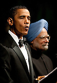 Washington, DC - November 24, 2009 -- United States President Barack Obama, left, and Manmohan Singh, India's prime minister, speak during the State Dinner on the South Lawn of the White House in Washington, D.C., U.S., on Tuesday, November 24, 2009. Obama welcomed India's role as a rising and responsible global power, saying the U.S. will follow through on a civilian nuclear agreement and work to expand trade and investment ties with the world's largest democracy. .Credit: Andrew Harrer - Pool via CNP