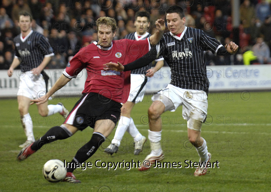 10/03/2007       Copyright Pic: James Stewart.File Name : sct_jspa17_dunfermline_v_st_mirren.KIRK BROADFOOT CLEARS FROM ADAM HAMMILL.....James Stewart Photo Agency 19 Carronlea Drive, Falkirk. FK2 8DN      Vat Reg No. 607 6932 25.Office     : +44 (0)1324 570906     .Mobile   : +44 (0)7721 416997.Fax         : +44 (0)1324 570906.E-mail  :  jim@jspa.co.uk.If you require further information then contact Jim Stewart on any of the numbers above.........