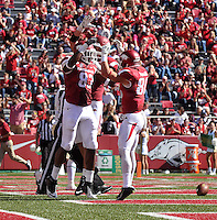 NWA Media/Michael Woods --10/25/2014-- w @NWAMICHAELW...University of Arkansas tight end Jeremy Sprinkle celebrates with teammates after scoring a touchdown in the 3rd quarter of Saturday's game at Razorback Stadium in Fayetteville.
