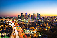 Photograph of the Dallas skyline at dusk with vehicle traffic as viewed from CityPlace tower in Dallas Texas. Dallas stock photography.