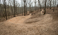 NWA Democrat-Gazette/BEN GOFF @NWABENGOFF<br /> A new downhill trail snakes its way through the woods Wednesday, April 11, 2018, at Lake Leatherwood Park in Eureka Springs. The park is adding six new downhill lines.