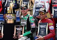 Sept. 14, 2012; Concord, NC, USA: NHRA pro stock motorcycle rider Andrew Hines (left) and Hector Arana Sr pose next to the championship trophy during qualifying for the O'Reilly Auto Parts Nationals at zMax Dragway. Mandatory Credit: Mark J. Rebilas-