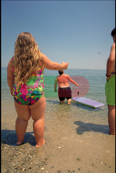 overweight children playing at the beach
