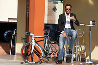 Mario Cipollini with RB800 bicycle outside cafe drinking coffee<br /> Cipollini clothing factory visit <br /> Mantova, Italy , November 2009<br /> pic copyright Steve Behr / Stockfile