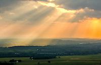 Sunrise over the Arkansas River Valley as seen from the Petit Jean Gravesite Overlook at Petit Jean State Park near Morrilton Arkansas.