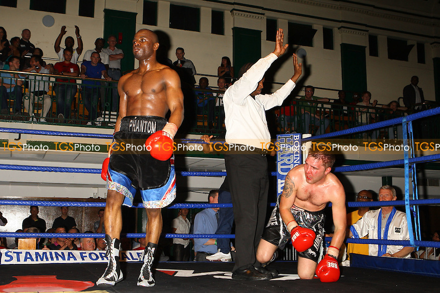 Tony Salam (black shorts) defeats Shon Davies in a Super-Middleweight Boxing contest at York Hall, Bethnal Green, promoted by Hard Knocks / Spencer Fearon - 04/06/10 - MANDATORY CREDIT: Gavin Ellis/TGSPHOTO - Self billing applies where appropriate - Tel: 0845 094 6026