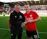 Chris Wilder manager of Sheffield Utd presents Paul Coutts of Sheffield Utd with a token to mark his 100 first team starts during the Championship match at Bramall Lane Stadium, Sheffield. Picture date 16th September 2017. Picture credit should read: Simon Bellis/Sportimage
