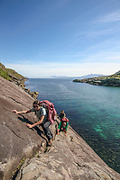 BNPS.co.uk (01202 558833)<br /> Pic: GeoffAllan/BNPS<br /> <br /> Negotiating the 'Bad Step' on an epic days hike in the shadow of Skye's Cuillin mountains.<br /> <br /> Wilderness walks - new book takes you down paths less travelled in the beautiful Scottish highlands.<br /> <br /> The stunning photos reveal Scotland's best remote walks, and also provide a rudimentary roof over your head at the end of the day. <br /> <br /> Geoff Allan has spent over 30 years travelling the length and breadth of the scenic country, passing through idyllic and untouched landscapes.<br /> <br /> The routes he has selected feature secret beaches, secluded glens, hidden caves and mountains.<br /> <br /> They also include bothies - remote mountain huts - which provide overnight shelter in the wilderness.<br /> <br /> Geoff has listed his top 28 trails complete with GPS maps and descriptions in his book Scottish Bothy Walks.