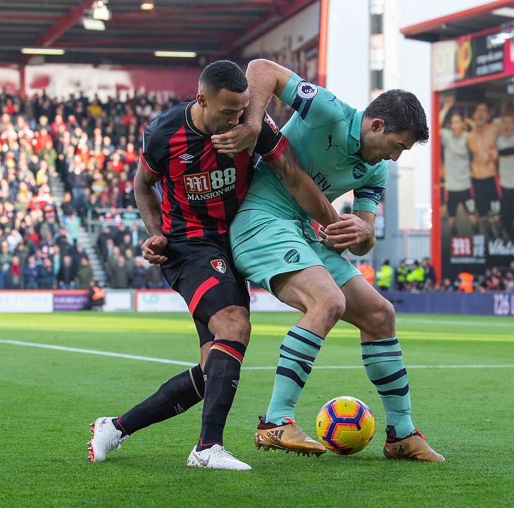Bournemouth's Callum Wilson (left) battles with Arsenal's Sokratis Papastathopoulos (right) <br /> <br /> Photographer David Horton/CameraSport<br /> <br /> The Premier League - Bournemouth v Arsenal - Sunday 25th November 2018 - Vitality Stadium - Bournemouth<br /> <br /> World Copyright © 2018 CameraSport. All rights reserved. 43 Linden Ave. Countesthorpe. Leicester. England. LE8 5PG - Tel: +44 (0) 116 277 4147 - admin@camerasport.com - www.camerasport.com