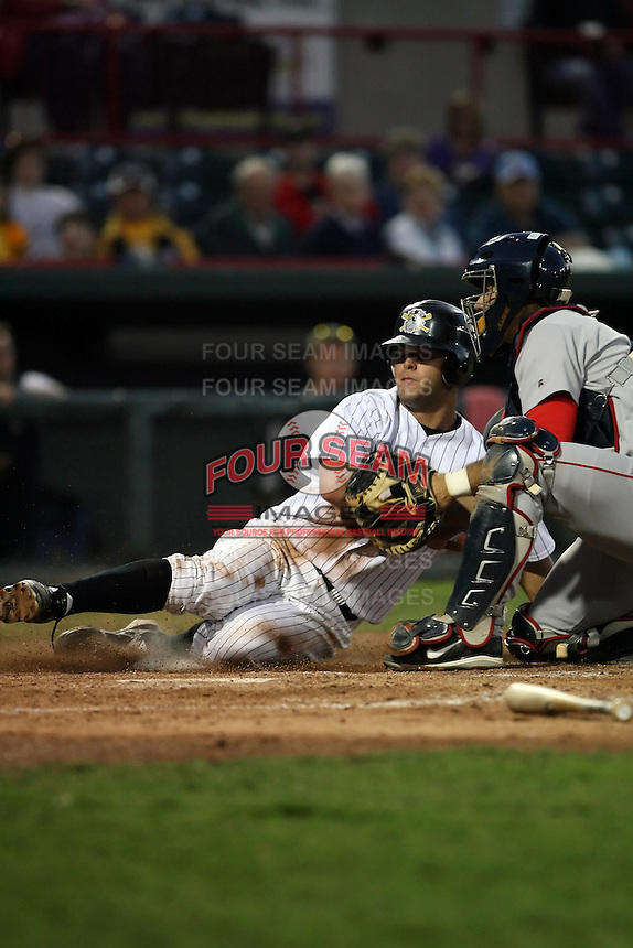 June 10th 2008:  Justin Justice (23) of the Erie Seawolves, Class-AA affiliate of the Detroit Tigers, slides into home vs Mark Wagner (5) of the Portland Seadogs during a game at Jerry Uht Park in Erie, PA.  Photo by:  Mike Janes/Four Seam Images