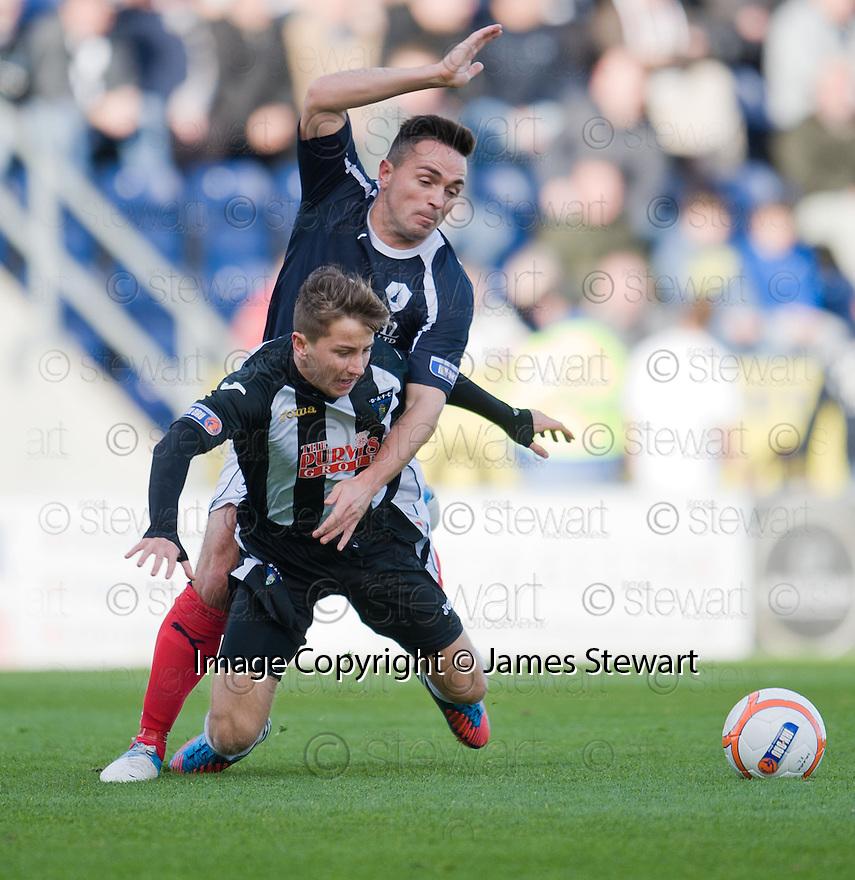 Falkirk's Sean Higgins goes into the back of Pars' Josh Falkingham  ...