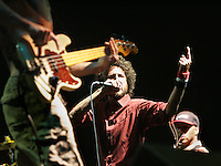 Indio, Ca.- Rage Against The Machine's , Zack de la Rocha, center, performs during finale of the 8th annual Coachella Valley Music and Arts Festival. Sunday, April 29, 2007.