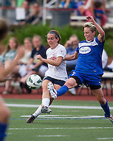 Sky Blue FC midfielder Katy Frierson (17) kicks a long pass as Boston Breakers midfielder Joanna Lohman (11) tries to intercept.  In a National Women's Soccer League Elite (NWSL) match, Sky Blue FC defeated the Boston Breakers, 3-2, at Dilboy Stadium on June 16, 2013