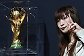 Apr 25, 2010 - Tokyo, Japan - A visitor poses with the World Cup trophy during a one-day special event at Laforet Harajuku in Tokyo, on April 25, 2010. The trophy arrived in Japan on April 23, as part of its 225-day global tour in the lead-up to the finals of the FIFA World Cup football tournament in South Africa.
