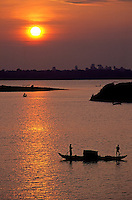 Sunset over the Mekong River, viewed from the bank of the Mekong River in Phnom Penh, Cambodia