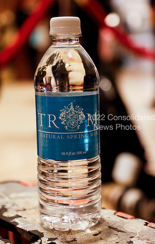 A Trump bottle of water in the lobby of the Trump Tower, while United States President-elect Donald Trump is holding meetings on top floors of the Trump Tower, November 21, 2016, in New York, New York.<br /> Credit: Aude Guerrucci / Pool via CNP