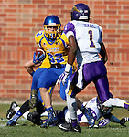 BROOKINGS, SD - OCTOBER 24:  Kyle Paris #32 from South Dakota State looks for room around Deiondre' Hall #1 from University of Northern Iowa in the first quarter of their game Saturday afternoon at Coughlin Alumni Stadium in Brookings. (Photo by Dave Eggen/Inertia)