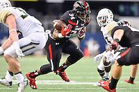 Texas Tech running back Kenny Williams (34) fumbles the ball during NCAA Football game, Saturday, November 29, 2014 in Arlington, Tex. (Mo Khursheed/TFV Media via AP Images)