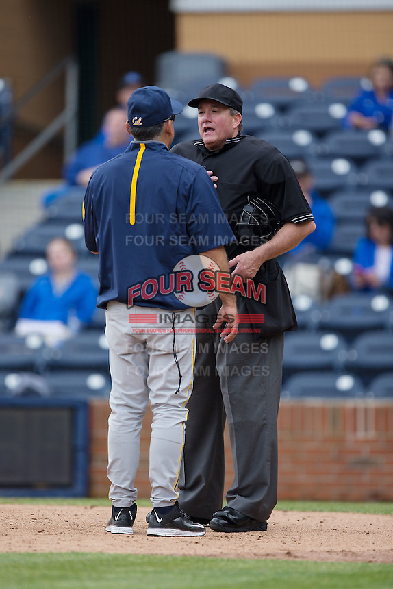 Home plate umpire Reid Churchhill explains a call to California Golden Bears head coach David Esquer during the game against the Duke Blue Devils at Durham Bulls Athletic Park on February 20, 2016 in Durham, North Carolina.  The Blue Devils defeated the Golden Bears 6-5 in 10 innings.  (Brian Westerholt/Four Seam Images)