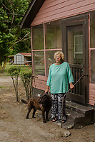 Elsie Herring and her dog, Midnight, live near a hog waste spray field. Her home off Beulah Herring Lane (named after her late mother) is on land that has been in her family for generations. She is a party in a nuisance lawsuit against Major Murray Farm, which contracts with Murphy-Brown LLC, because of the horrible odor of the hog waste and the vermin and pests (insects, snakes) it attracts to her property, which interfere with her quality of life. She also claims that hog industry is trying to take her families land from her, by manipulating the deeds. Wallace, NC Wednesday, May 16, 2018. (Justin Cook for The Guardian)