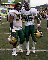 Walt Walker (75) and George Selvie (95) after the South Florida Bulls defeated the Pitt Panthers 48-37 on November 24, 2007 at Heinz Field, Pittsburgh, Pennsylvania.