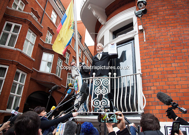NON EXCLUSIVE PICTURE: MATRIXPICTURES.CO.UK<br /> PLEASE CREDIT ALL USES<br /> <br /> WORLD RIGHTS<br /> <br /> WikiLeaks founder Julian Assange addresses a crowd from a balcony in the Ecuadorean embassy in central London.<br /> <br /> The Austrian WikiLeaks editor-in-chief is demanding that a UN panel's ruling that he should be allowed to go free, should be respected.<br /> <br /> Assange - who faces extradition to Sweden over a rape claim, which he denies - claimed asylum in London's Ecuadorean embassy in 2012.<br /> <br /> FEBRUARY 5th 2015<br /> <br /> REF: BJJ 16318