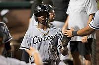 Center fielder Luis Robert (15), on rehab assignment with the AZL White Sox, is congratulated by teammates after scoring a run during an Arizona League game against the AZL Angels at Tempe Diablo Stadium on August 3, 2018 in Tempe, Arizona. The AZL White Sox defeated the AZL Angels 6-4. (Zachary Lucy/Four Seam Images)