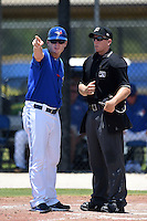 GCL Blue Jays manager Kenny Graham (6) argues a call with umpire Chris Marco during a game against the GCL Yankees 2 on July 2, 2014 at the Bobby Mattick Complex in Dunedin, Florida.  GCL Yankees 2 defeated GCL Blue Jays 9-6.  (Mike Janes/Four Seam Images)