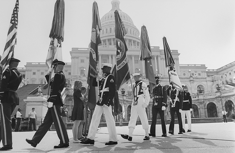 Joint military color guard departs West Front on Capitol Hill. After presentation of colors. Part of ceremony sponsored by U.S. Capitol Historical Society on June 14, 1994. (Photo by Maureen Keating/CQ Roll Call via Getty Images)