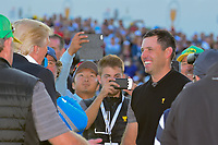President Trump visits with Charl Schwartzel (RSA) following  round 4 Singles of the 2017 President's Cup, Liberty National Golf Club, Jersey City, New Jersey, USA. 10/1/2017. <br /> Picture: Golffile | Ken Murray<br /> <br /> All photo usage must carry mandatory copyright credit (&copy; Golffile | Ken Murray)
