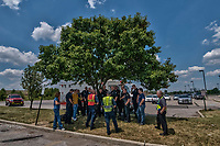 Westerville, Genoa and Ohio State university police officers and the Westerville Fire Department stand in the shade of a tree in the parking lot after training at a high school to refine their procedures and policies for school violence.